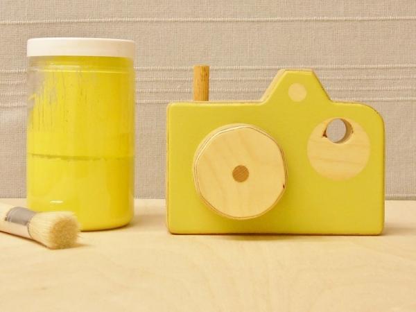 Limegroene houten camera